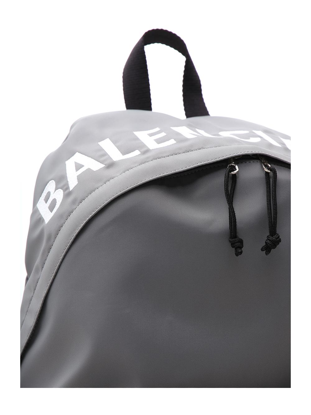6c18ade740 BALENCIAGA. Men s Wheel Logo-Print Backpack ...